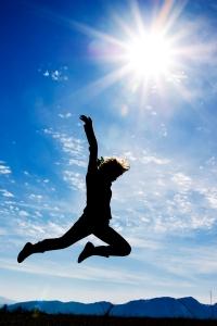 girl jumping blue sky