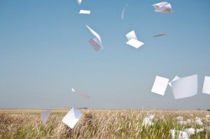 Paper Flying in Mid Air --- Image by © Sung-Il Kim/Corbis